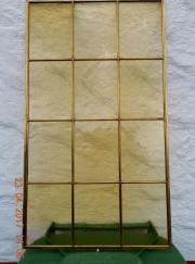 Messingrahmen mit 12 gelben Scheiben