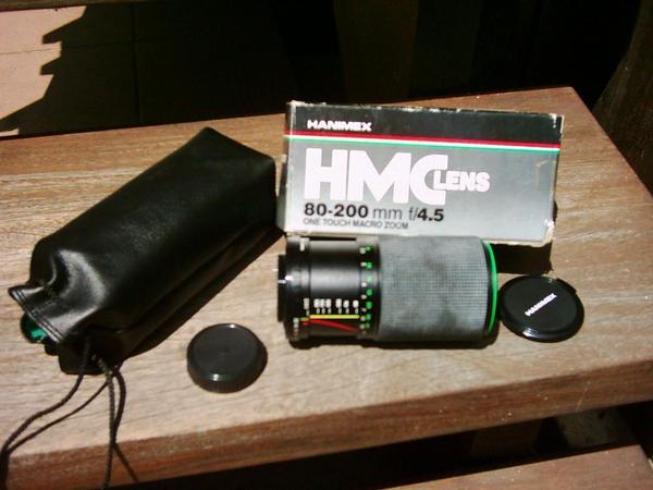 Objektiv Hanimex - Pfinztal - Hanimex HMC Objektiv 80-200mm f/4.5 für Schraubanschluß (Außendurchmesser des Schraubanschlusses 41,7 mm) mit Originalkarton, Transporttasche und Schutzkappen. War mal auf einer Revue-Kamera, paßt aber sicher auch auf andere Hersteller. Tec - Pfinztal